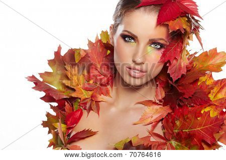 Autumn woman dressed in red leaves