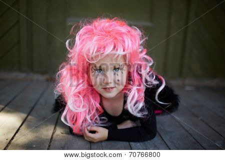 Portrait of cute girl with pink hair looking at camera
