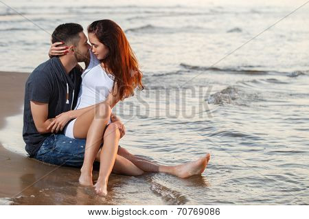 Summer, love. Attractive couple on the beach