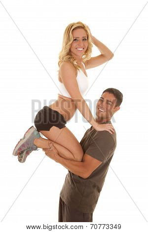 Fitness Man Hold Woman Up By Legs Both Look Smile
