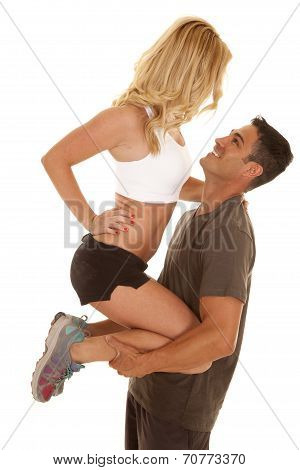 Fitness Man Hold Woman Up By Legs Facing Each Other