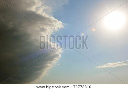 Sky. Cloud coming in the sun.
