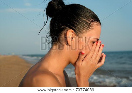 Close-up Of A Young Woman  Rubbing  Irritated Sensitive Eyes On The Beach