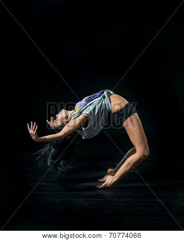 Young Ballet Dancer Dansing On black Background