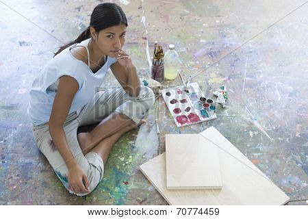 Artist With Canvas and Paintbrushes on Floor of Studio