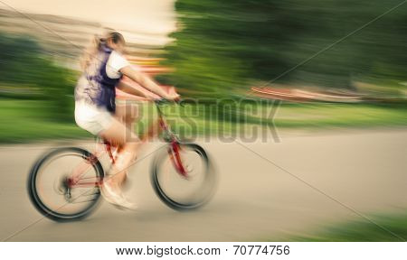 Girl Cyclist In Traffic On The City Roadway