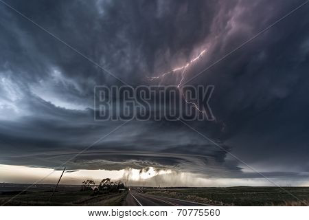 Amazing supercell lighted up by lightnings at dusk