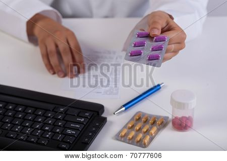 Pharmacist's Hands During Realizing Prescription