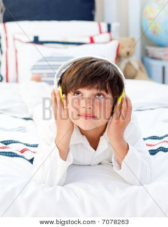 Cute Little Boy Listening Music With Headphones On