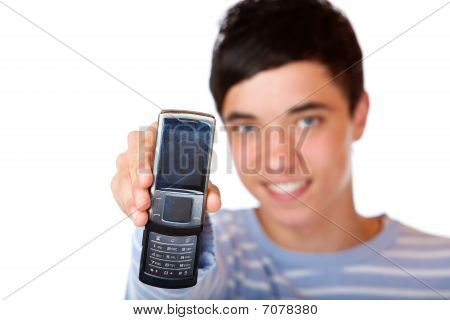 Young Handsome Happy Smiling Male Teenager Shows Mobile Phone