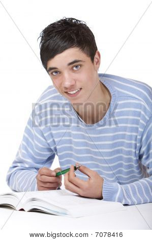 Young Happy Male Student Lying On Floor Learning From Study Books