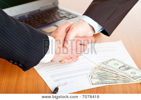 Handshake Of Businessmen After Signing A Contract