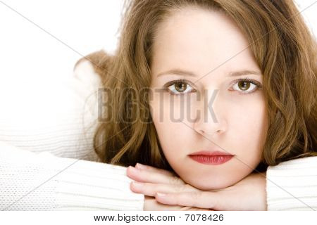 Young Beautiful Woman Looking Sad Into Camera