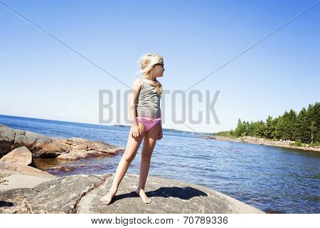 Child On Rocky Beach In Sweden