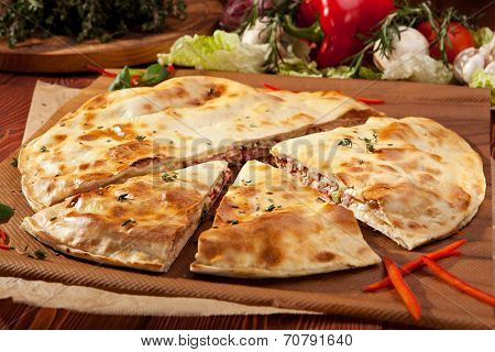 Pizza Calzone with Chicken and Vegetables