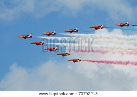 EASTBOURNE, ENGLAND - AUGUST 14, 2014: RAF aerobatic team The Red Arrows perform at the Airbourne airshow. Formed in 1965, the team are in their 50th display season.