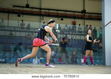 AUGUST 19, 2014 - KUALA LUMPUR, MALAYSIA: Delia Arnold of Malaysia plays Alison Waters of England (red skirt) in a match in the CIMB Malaysian Open Squash Championship 2014.