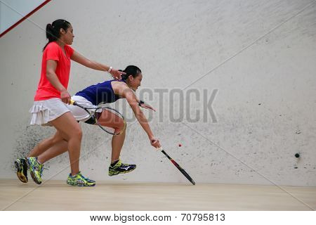 AUGUST 19, 2014 - KUALA LUMPUR, MALAYSIA: Low Wee Wern (Malaysia) rushes to return the ball in her match against Heba El Torky (Egypt) in the CIMB Malaysian Open Squash Championship 2014.