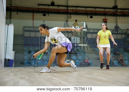 AUGUST 19, 2014 - KUALA LUMPUR, MALAYSIA: Raneem El Weweily of Egypt (white top) rushes forward to hit a return in her match against Tesni Evans in the CIMB Malaysian Open Squash Championship 2014.