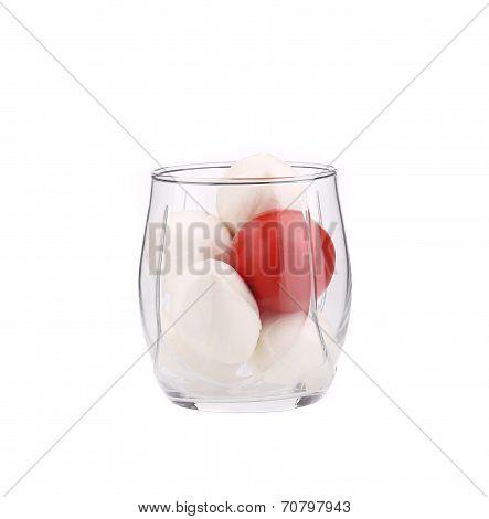 Glass of tomato and mozarella.