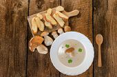 stock photo of chinese parsley  - Mushrooms soup creame with czech mushrooms from wood - JPG