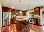 image of granite  - Bright shiny kitchen room with granite tops tile back splash trim and steel stainless appliances - JPG