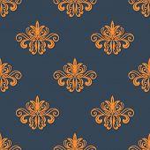 stock photo of indigo  - Floral vintage retro orange seamless pattern on indigo or dark blue background - JPG