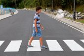 pic of zebra crossing  - Teenager through a zebra crossing in his town - JPG