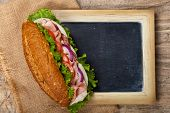 stock photo of deli  - Deli sub Sandwich with chalkboard - JPG