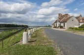 foto of dike  - Dike road and houses near the Loire in France - JPG