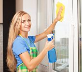 foto of window washing  - Woman washing window - JPG