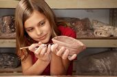 image of molding clay  - Cute young girl in clay studio working on a bowl - JPG