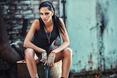 pic of cun  - sexy brutal woman sitting in factory ruins and holding handgun - JPG
