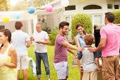 picture of niece  - Multi Generation Family Enjoying Party In Garden Together - JPG
