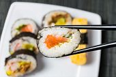 stock photo of chopsticks  - close up of chopsticks and sushi - JPG