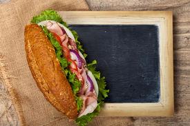 stock photo of deli  - Deli sub Sandwich with chalkboard - JPG