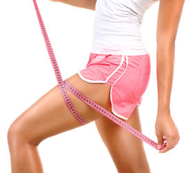 image of measurement  - Fitness sporty woman measuring her hip with a measuring tape - JPG