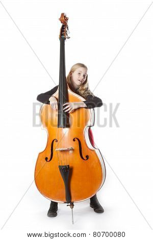 Young Girl Holds Double Bass In Studio