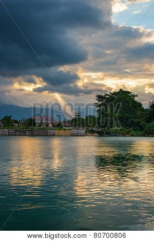 Cloudscape And Sunbeams On Lake