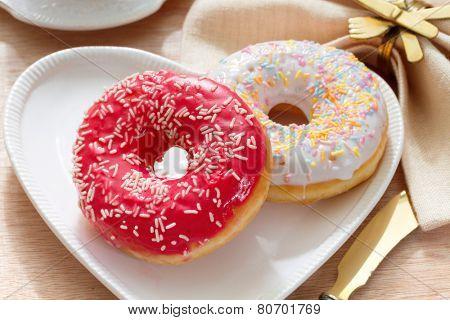 Delicious doughnut with confectioner's sugar.