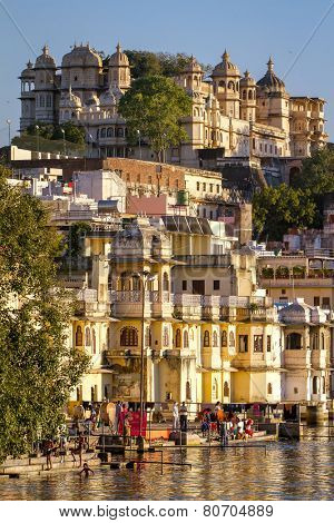 UDAIPUR, INDIA - DECEMBER 10: People near City Palace and Pichola lake in Udaipur, Rajasthan, India on December 10, 2012.