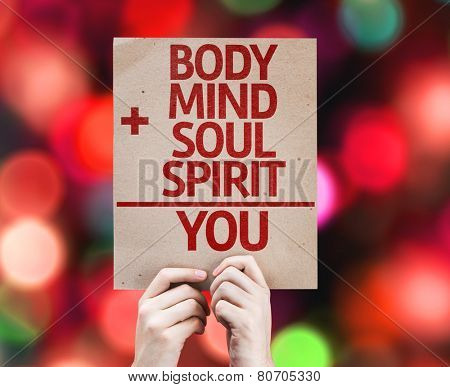 Body + Mind + Soul + Spirit = You card with colorful background with defocused lights