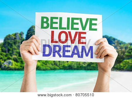 Believe Love Dream card with a beach on background