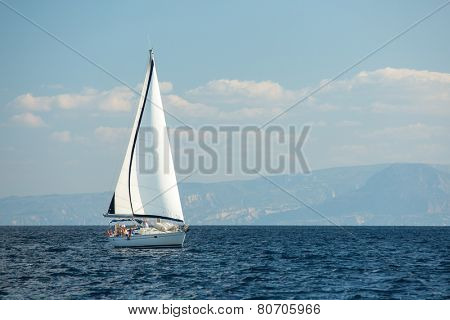 GALAXIDI, GREECE - SEP 29, 2014: Unidentified sailboats participate in sailing regatta