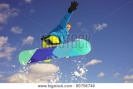 young man take fun on the snowboard