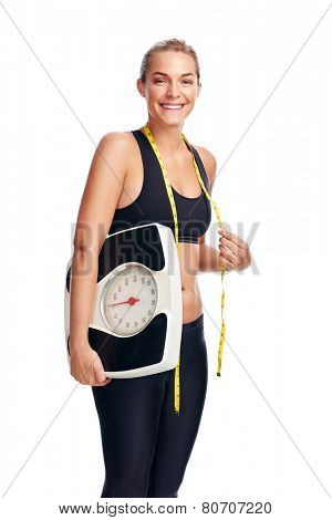 Women with scale cheering for achieving her weight loss goal isolated on white background