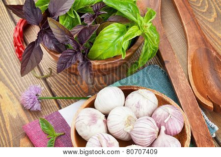 Fresh farmers basil and spices on wood table