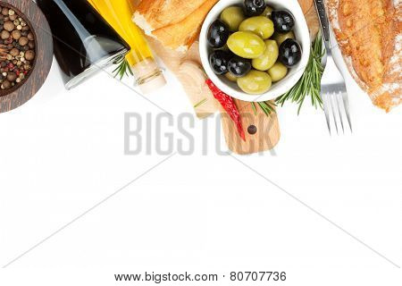 Italian food appetizer of olives, bread and spices. Isolated on white background