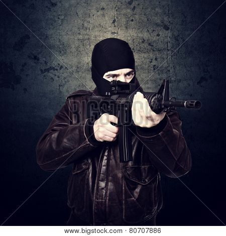 portrait of terrorist and grunge background
