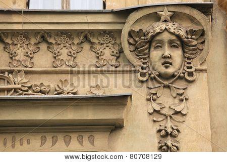 Mascaron on the Art Nouveau building in Prague, Czech Republic.